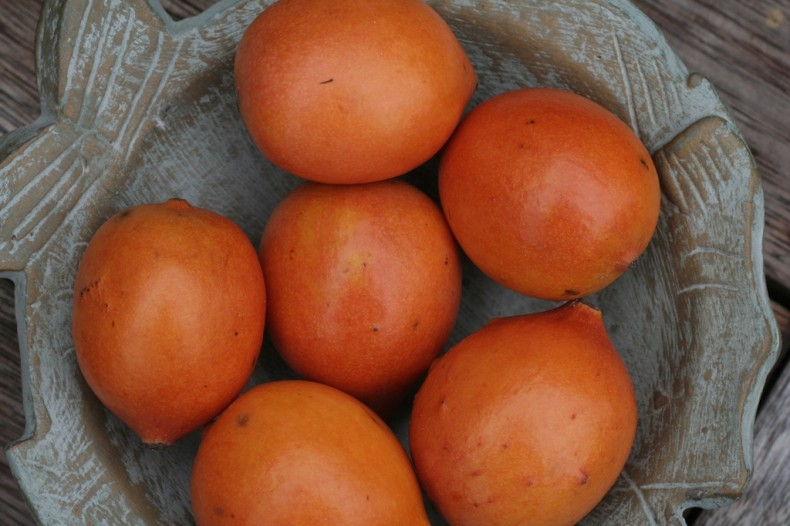 Small egg-shaped orange achacha fruit