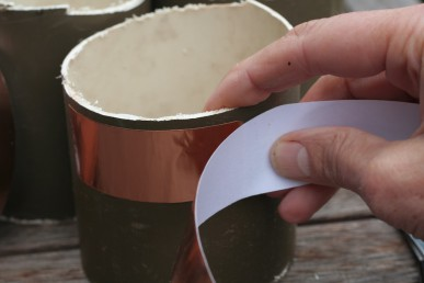 Use the sticky copper take to make a collar.